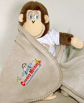 The original Chunky Monkey doll and logo fleece blanket package